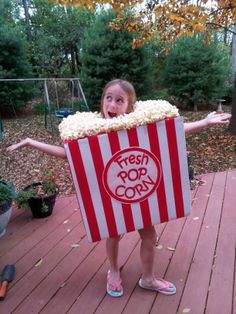 Kid's Halloween Costume made with a large box. Cut out arm, head, and leg openings. Spray paint white. Use red duct tape for stripes. Hot glue real popcorn to top. To make logo--cut out circle from poster board, edge with red permanent marker, glue on red lettering.