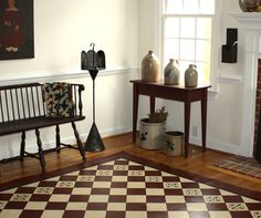 Love the floorcloth and display of crocks in this pretty room