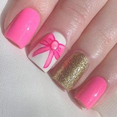 Pink, gold, bows manicure