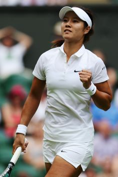 Na Li of China celebrates a point during her Ladies' Singles first round match against Paula Kania of Poland on day one of the Wimbledon Lawn Tennis Championships at the All England Lawn Tennis and Croquet Club at Wimbledon on June 23, 2014 in London, England. (Photo by Matthew Stockman/Getty Images)