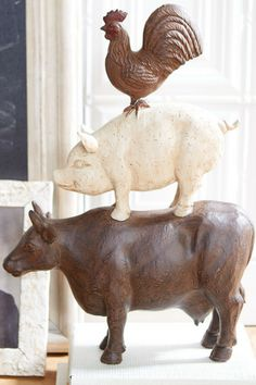 I love this farmhouse style arm-animal stack. It makes the kitchen counter more charming and a dining display more inviting. These farm animals are sure to win a permanent spot in our home. #ad #animal #farmhouse #rustic #sculpture #homedecor #kitchen #farm