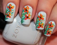 Tropical floral nail art http://www.setinlacquer.com/2013/08/tropical-floral-nail-arttropical-floral.html