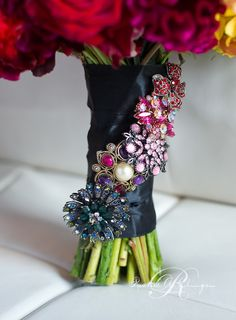 Beautiful bridal bouquet details. Antique broaches accent the satin wrapped stems.