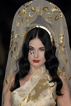 Dita Von Teese walking for Jean Paul Gaultier. Spring 2007 couture.