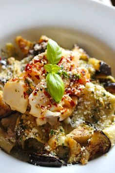 Grilled aubergine and toasted walnut pesto with chili-lemon cod fillets en papillote