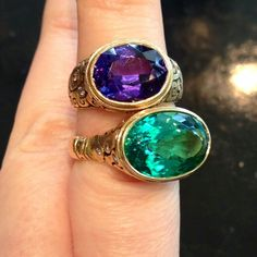 Does color get any more magical than this!?! Tanzanite and Tourmaline rings by Alex Sepkus.