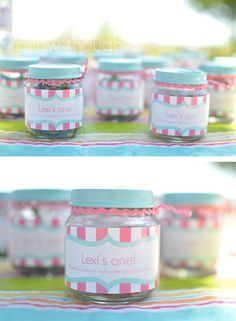 party favor using baby food jars. (Use a pic of Sadie and red or pink jelly beans) paint lids and use color themed ribbon.