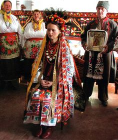 Ukraine | A wedding in age-old traditional style; The parents of the bride (to the left of her) bless her with a choir from the village of Kydrasivka singing wedding songs. | ©Ukrainian Folk Culture Centre
