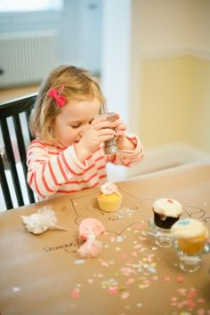 I'm kinda over the whole cupcake fad. But the idea of a cupcake decorating birthday party is pretty neat!