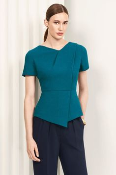 The Boswell top channels clean lines and soft angles, made in rich green crepe with a signature folded neckline. Traditional Dresses Designs, Traditional Outfits, Indian Fashion Dresses, Fashion Outfits, Pretty Outfits, Stylish Outfits, Corporate Attire, Pantsuits For Women, Professional Wardrobe