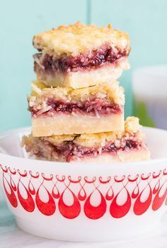 Raspberry coconut bars, the perfect bar recipe! It freezes well and tastes amazing! Perfect for your Christmas or holiday dessert table! Holiday Desserts, Holiday Baking, Christmas Baking, Just Desserts, Dessert Recipes, Christmas Treats, Christmas Cookies, Christmas Fudge, Bar Recipes