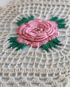 "Watch Maggie review this gorgeous Solitary Rose Runner Pattern! ) Edited By: Maggie Weldon Skill Level: Easy Size: About 18"" wide and 8"" long. Materials:Size 10 Cotton Crochet Thread: Pink - 25 yds; G"