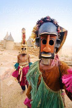 Africa, West Africa, Mali, Dogon Country, Bandiagara escarpment, Masked Ceremonial Dogon Dancers near Sangha by GHProductions | Stocksy United