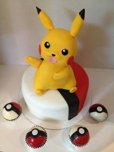 Pokemon pikachu cake with edible chocolate pokeball cupcakes !