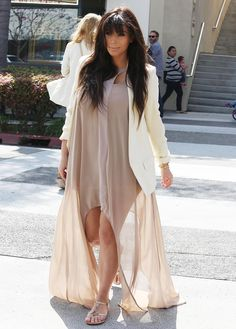 kim kardashian pregnant pictures May 2013: I absolutely love this loose-fitting beige dress with the white cardigan look that she's wearing. It looks comfortable and the way it flows looks beautiful.