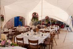 Marquee set up in Courtyard area - Lulworth Castle & Courtyard. Courtyard Wedding, Country Garden Weddings, Countryside Wedding, Wedding Decorations, Table Decorations, Wedding Pictures, Wedding Ideas, Floral Centerpieces, Real Weddings