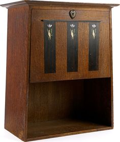 Arts and Crafts style cabinet design made from oak, with ebony panelling.   A little touch of detail is shown, on each panel has a hand painted bird and flower. Very simplistic.