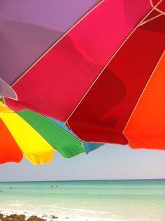 Rainbow Umbrellas at the Beach
