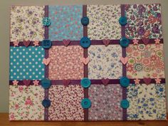 Fabric, ribbon and Button on canvas