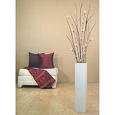 white mitsumata with black branches in black vase | white branches