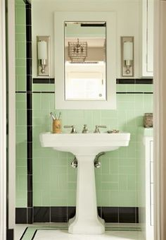 Bathroom sporting our mid-century green/black tile. Of course it's in superb condition and we must work around it. hhmmmmm...why not add grey to color chart in this room?!