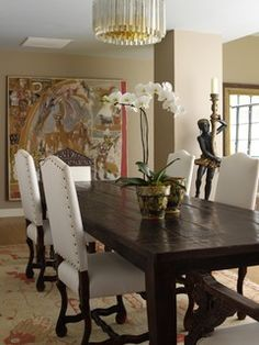 Dining room - beautiful rustic farm table paired with elegant chairs - crystal chandelier - tapestry | Tara Seawright