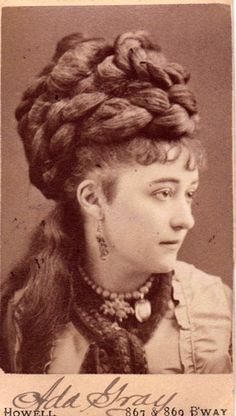 Contemporary carte de visite, 1860s This Victorian lady has probably given nature a hand in forming the huge cable twists and braids which form her chignon.