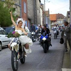 A wedding with the right getaway vehicles- the bride enjoying her dirtbike (as she should!) and groom following on his Suzuki sportbike (sou...