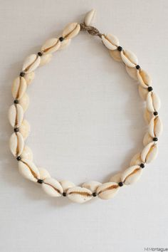 Wear this sublime cowry shell necklace and be the most stylish girl in the room.Has a stacked side pattern that is amazing.Such cool chic. Easy to wear and super chic! Available at Maryam Montague's online Souk!