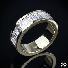 { Men deserve diamonds too - unique Diamond Wedding Band is set in 18k Yellow Gold and holds 1.75ctw straight baguettes. The width is 6mm and is a half eternity. }