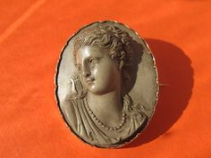 Antique Lava Cameo depicting the profile of a lady from ancient Rome ,fourteen karat yellow gold, dated at the 19th century