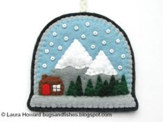 tutorial to make a felt snowglobe ornament. I definitely want to try these. :D