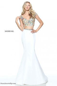 Sherri Hill 51167 is a 2-piece prom dress with a cap sleeved beaded crop top and a taffeta mermaid skirt.