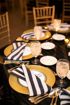 Black and white napkins/linen with gold flatware. Tent + Rentals: Premier Rentals & Weinhardt | Wedding Day Coordination: Perfect Day Wedding & Events, Tami Heroff / Linens: BBJ Linens. Photography: Heather Roth Fine Art Photography - www.heatherrothphotography.com Read More: http://www.stylemepretty.com/2014/06/12/gorgeous-fall-wedding-in-st-louis/