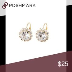 White Crystal & Gold Round-Cut Drop Earrings Set in gilded brass, a halo frame of pavé stones wraps a round-cut white crystal in a sparkling embrace. Lever backs promise a comfortable and secure fit.  0.6'' L 18k gold-plated brass / crystal Made in Brazil Jewelry Earrings