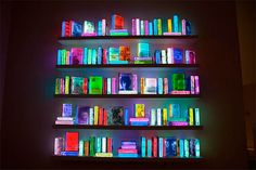I would love an entire accent wall full of these colorful LED books.