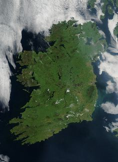 Ireland on the first day this summer that most of the island hasn´t been completely obscured by cloud cover.  Ireland is draped in vibrant shades of green amidst the blue Atlantic Ocean and Celtic (south) and Irish (east) Seas. Faint ribbons of blue-green phytoplankton drift in the waters of the Celtic Sea, just south of Dublin. This large capital city (population 1.12 million) sits on the River Liffey, effectively splitting the city in half