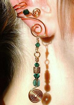 Copper wire earcuff with charms dangling. I wonder if I could make something like this.....