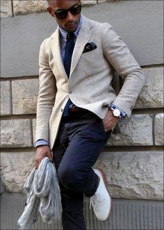Light tan/grey jacket, navy gingham shirt, navy knit tie, navy trousers