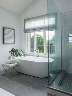 Clean, modern bathroom with sweet inspirational canvas print on the wall