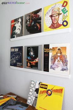 We made super easy record display shelves out of crown moulding.