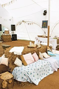 Tent chill out area - cushions, throws, hay bales | Festival wedding ideas | Vintage and Boho styling and hire for weddings, parties and events in Norfolk, Lincs and Cambs | Blog Post from Vintage Partyware | http://www.vintagepartyware.co.uk/blog/festivalwedding