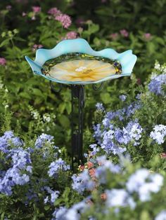 I want this! Art Glass Birdbath pretty and the birds will love it too. Will look nice by the porch.
