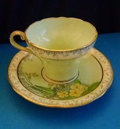 Aynsley Tea Cup & Saucer - Pale Green with Yellow Flowers Gold Trim - beautiful!
