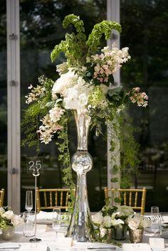 Metallic Wedding Centerpiece    Photography: lauren b. photography   Read More:  http://www.insideweddings.com/weddings/traditional-catholic-ceremony-romantic-tented-at-home-reception/664/