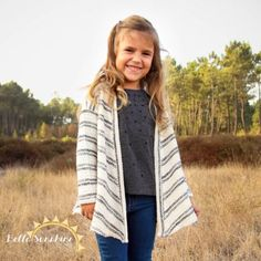 This is the cutest cardigan! I need this sewing pattern.  They have a mommy version too.