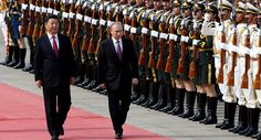 Aggressive US moves in Eastern Europe and the South China Sea have only led to Russia and China strengthening their economic and geopolitical cooperation, political commentator Mike Billington told Iranian news network PressTV.    Russian President Vladimir Putin (R) and his Chinese counterpart Xi Jinping attend a welcoming ceremony outside the Great Hall of the People in Beijing, China, June 25, 2016