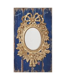 Ornate mirror farmed by distressed wood