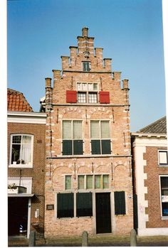 one day, Peter, Truus and i spent the day around in north Holland.  here we were in Edam, the Netherlands.  this building was interesting to me.  don't know the name/age of it.  Feb '92.