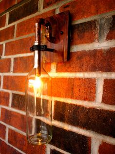 Cool for wine cellar or outdoor entertaining. Wine Bottle Light Lamp  Industrial Sconce  Clear by BSquaredInc